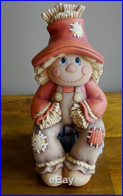 Ceramic Bisque Hand-Painted Scarecrow Sitting On A Stump, ! 2 Tall X 7 W