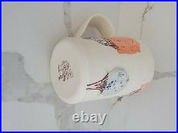 Lollipop pottery handmade and hand painted tall trees mug in yellow