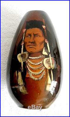 Wisecarver tall art pottery vase with hand painted Indian chief